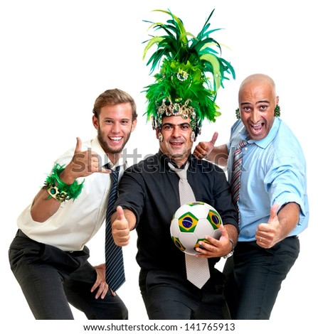 Team of businessmen with brazilian soccer ball and Carnaval colors - stock photo