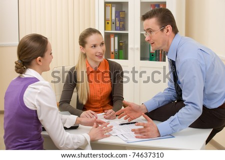 Team of businesspeople working together discussing  in the office - stock photo