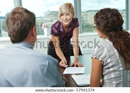 Team of casual looking business people having business meeting at office. - stock photo