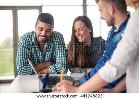 Team of colleagues working together on a project. - stock photo