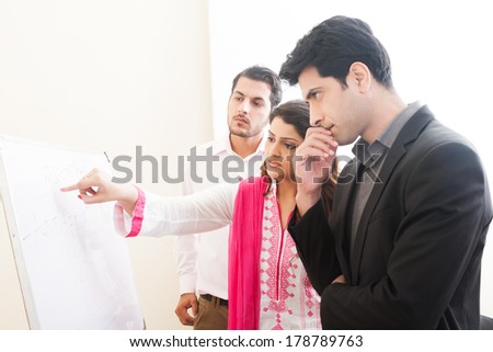 team of confident business people, Indian businesswoman with her colleagues  - stock photo