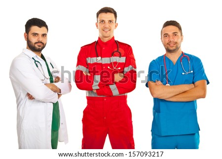 Team of different doctors standing with arms folded isolated on white background - stock photo