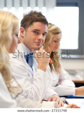 Team of doctors at a meeting - stock photo