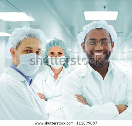 Team of doctors in modern hospital lab - stock photo