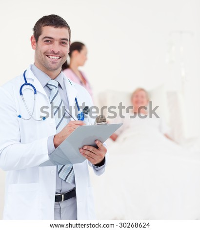 Team of Doctors Looking after a senior Patient - stock photo