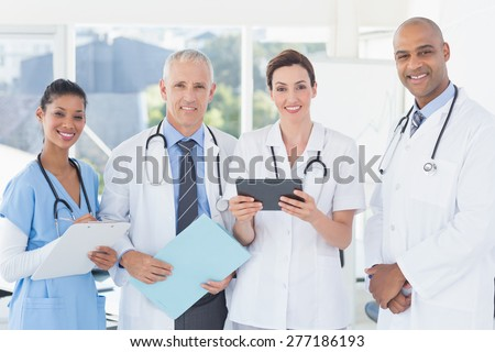 Team of doctors working together on patients file in medical office - stock photo