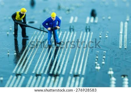 Team of engineers repairing circuit board. Computer repair concept - stock photo