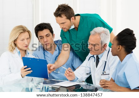 Team Of Experts Doctors Examining Medical Exams - stock photo