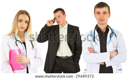 Team of friendly and happy doctors and nurses over a white background - stock photo