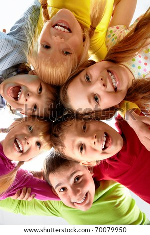 Team of happy kids embracing each other - stock photo
