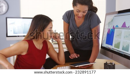 Team of multi-ethnic businesswomen working in office - stock photo