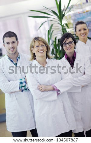 team of  pharmacist chemist woman and man  group  standing in pharmacy drugstore - stock photo