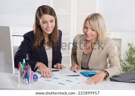 Team of successful businesswoman in the office: concept for equal rights or woman in leading positions. - stock photo
