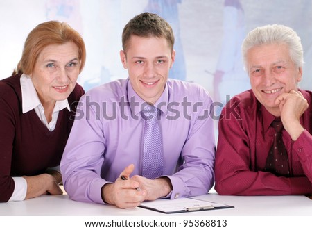 team of three people sitting on a white - stock photo