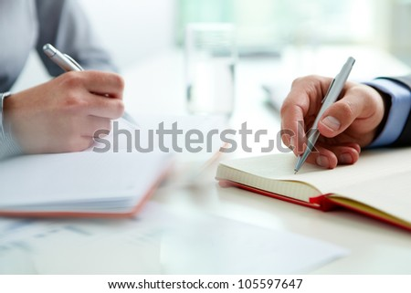 Team of two dealing with current business matters - stock photo