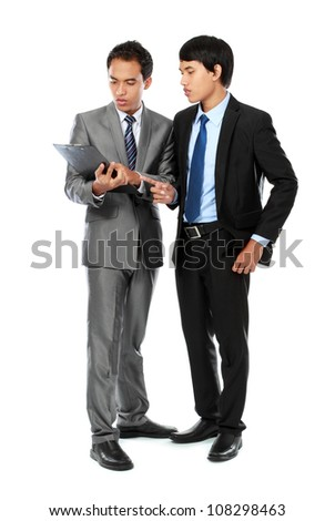 Team of young asian businessman with paperclip discussing something isolated on white background - stock photo