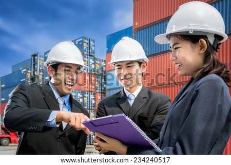 Team of young businesspeople meeting in logistic port. - stock photo
