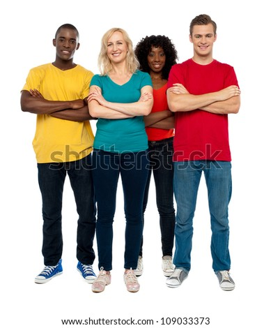 Team of young people standing with crossed hands against white background - stock photo