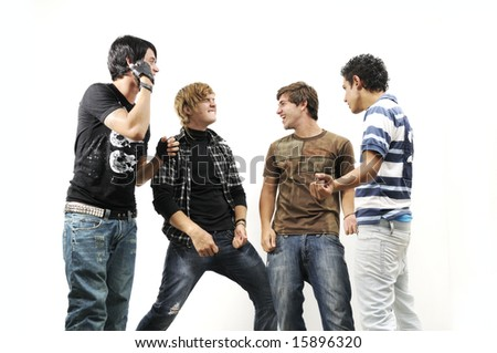 Team of young trendy teenagers standing isolated - stock photo