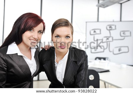 Team portrait of happy businesswomen standing at office - stock photo