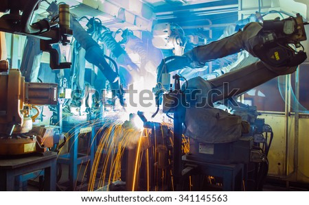 Team Robot welding movement Industrial automotive part in factory - stock photo