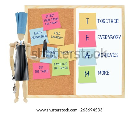 Team (Together Everybody Achieves More) Chef holding knife and ladle Post it notes(fold laundry, prepare dinner, empty dishwasher, set table, vacuum, set table) cork white board - stock photo
