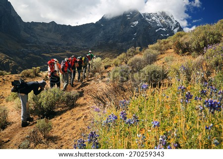 Team trekking in Cordiliera Huayhuash, Peru, South America - stock photo