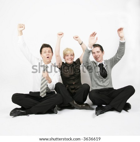 Team with success, arms in the air - stock photo