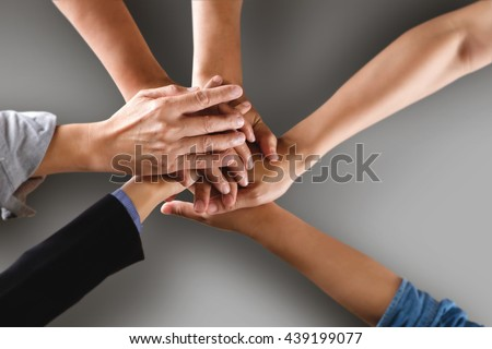 Team work business team showing unity with their hands together with clipping path. - stock photo