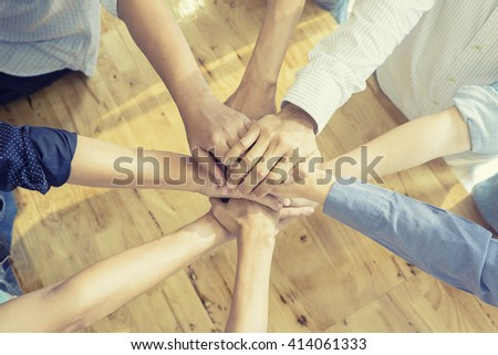 Team work concept.Business team standing hands together in the office.Business people joining hands.Group of Diverse Multiethnic People Teamwork Concept.selective focus,vintage color - stock photo