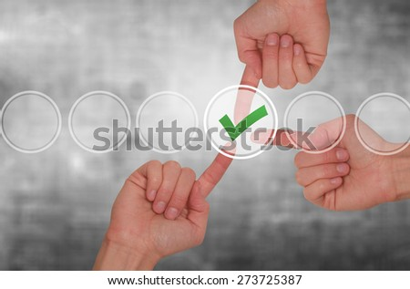 Team work hands touching check mark on virtual screen. Business technology concept. Isolated on grey. Stock Image - stock photo