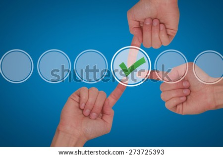 Team work hands touching check mark on virtual screen. Business technology concept. Isolated on blue. Stock Image - stock photo