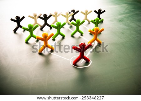 Team work organizational chart concept, colorful dolls on blackboard.  - stock photo