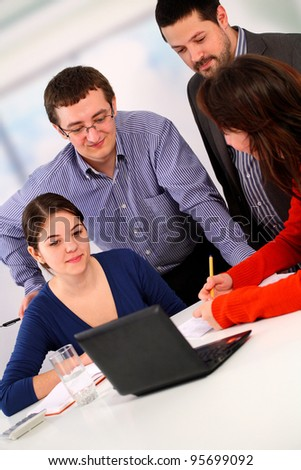 Team working in the office - stock photo