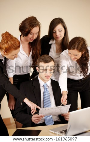 Team workng together. Two young girls showing on chart. - stock photo