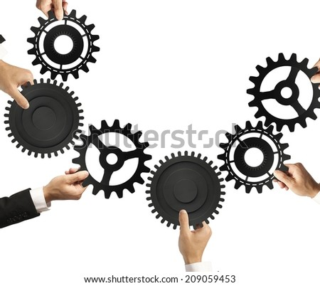 Teamwork and integration concept with connection of gear - stock photo