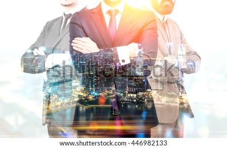 Teamwork and partnership concept with businesspeople crossing arms on illuminated Singapore city background at night. Double exposure - stock photo