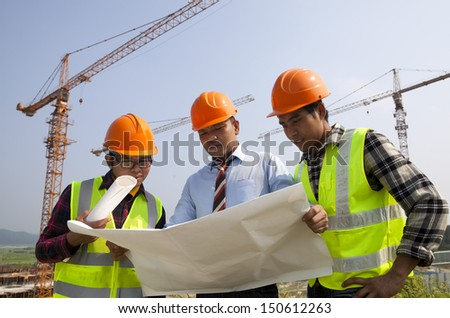 Teamwork building construction - stock photo