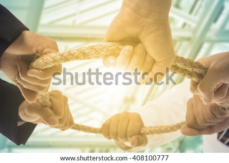 Teamwork businessman team ,team people hold rope circle concept.