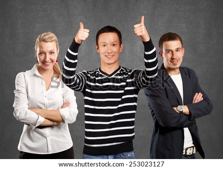 Teamwork concept. Asian man in striped pullovert, showing well done with both hands - stock photo