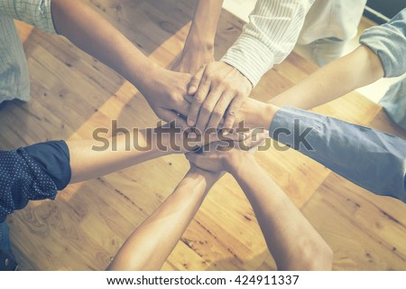 Teamwork concept,Business people team standing hands holding together in the office.cooperation success business,vintage color - stock photo