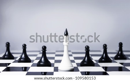 Teamwork concept in chess, providing leadership and association - stock photo