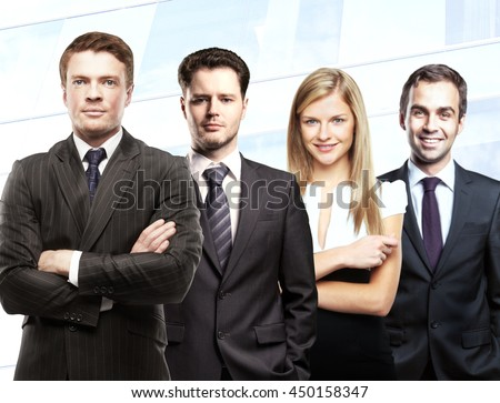 Teamwork concept with attractive white businessmen and woman on light background - stock photo