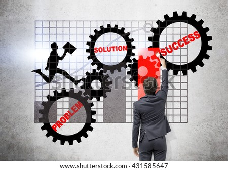 Teamwork concept with businessman drawing abstract sketch with gears and business chart on concrete background - stock photo