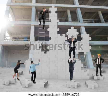 Teamwork cooperates for the construction of building - stock photo