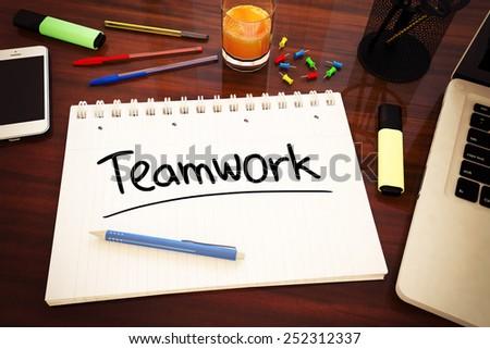Teamwork - handwritten text in a notebook on a desk - 3d render illustration. - stock photo