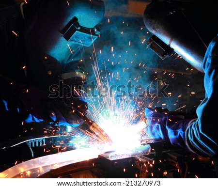 Teamwork in Welder skill up - stock photo