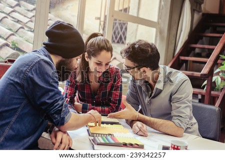 Teamwork. Three young architects working on a project - stock photo