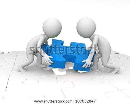 Teamwork/Two people are moving a piece of the puzzle - stock photo