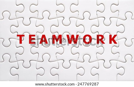 Teamwork word on white jigsaw puzzle pieces,business concept background - stock photo